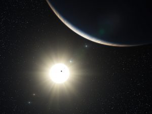 This artist's impression shows the remarkable planetary system around the Sun-like star HD 10180. Observations with the HARPS spectrograph, attached to ESO's 3.6-metre telescope at La Silla, Chile, have revealed the definite presence of five planets and evidence for two more in orbit around this star. This system is similar to the Solar System in terms of number of planets and the presence of a regular pattern in the sizes of the orbits. If confirmed the closest planet detected would be the lightest yet known outside the Solar System, with a mass that could be only about 1.4 times that of the Earth. The large crescent is the third world in the system (HD 10180d), which is comparable to the planet Neptune in mass. The two inner planets appear as silhouettes in transit across the bright disc of the star. The outer planets in the system appear in the background sky.